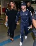 Priyanka Chopra and Nick Jonas draw a crowd of crazed fans arriving in Sao Paulo