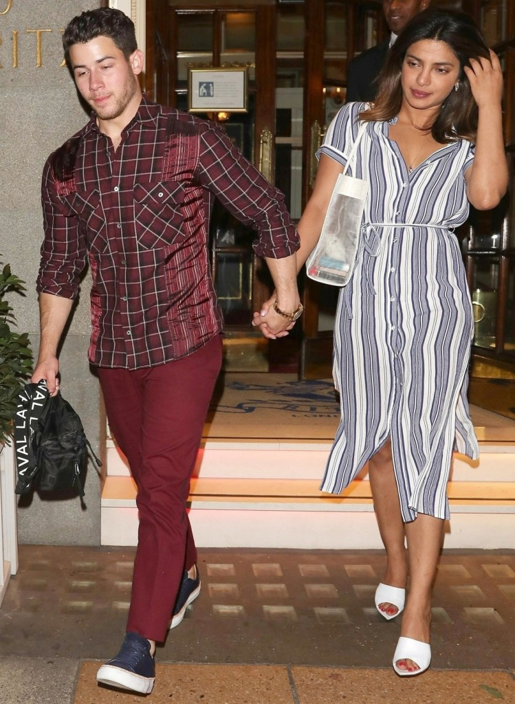 The Jonas Brothers have a double date with their ladies out at the Ritz Club in London