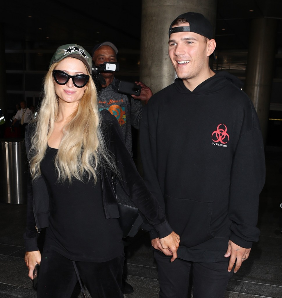 Paris Hilton and her fiance Chris Zylka arrive at Los Angeles International (LAX) Airport