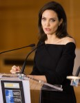 Angelina Jolie speaks to the press after a NATO meeting in Brussels