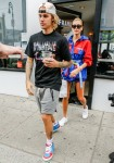 Hailey Baldwin and Justin Bieber hold hands while waiting for their coffee