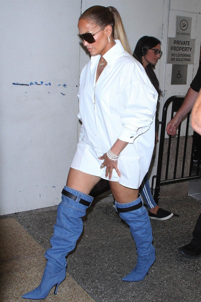 Jennifer Lopez shows off her blue jean inspired boots at TRL Am