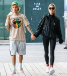 Justin Bieber takes Hailey Baldwin for a stroll ahead of another date night at the movie's