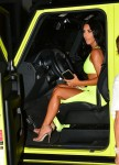 Kim Kardashian is hard to miss in a crowd stopping neon green look
