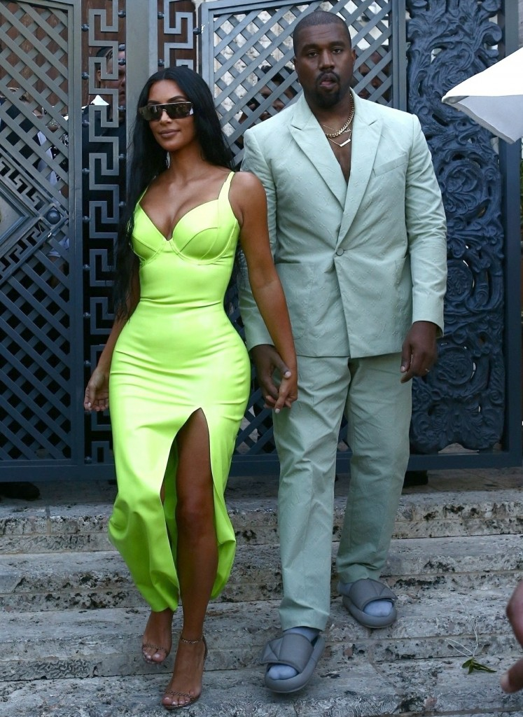 Kim Kardashian gets a helping hand from her man Kanye West while they grab ice cream