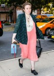 Lena Dunham is pretty in pink as she returns to her New York hotel