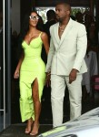 Kim Kardashian and Kanye West show off her unique wedding guest looks