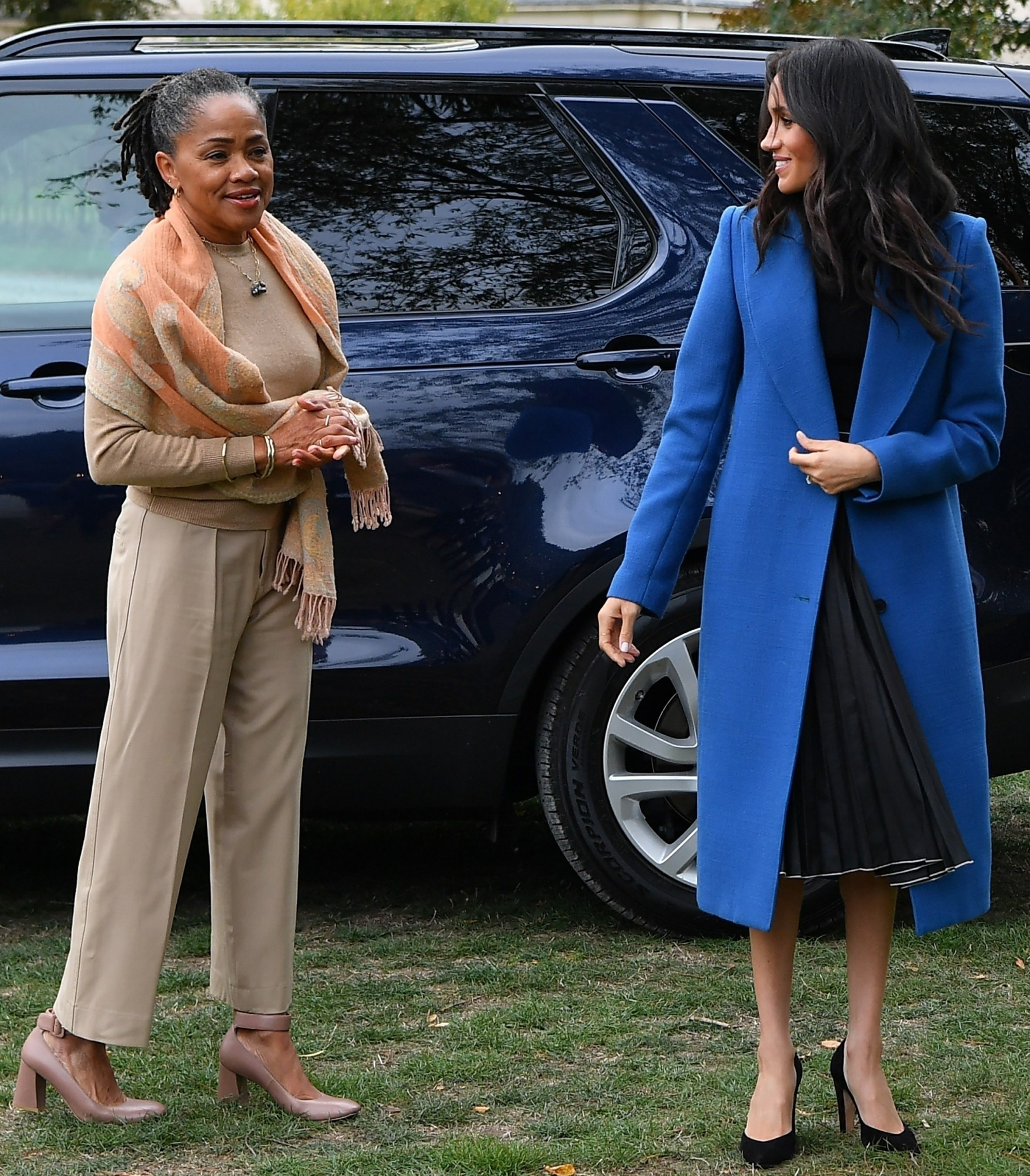 Meghan Markle takes her Mum to Grenfell Cookbook launch with Prince Harry