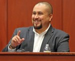 George Zimmerman smiles as he testifies in a Seminole County courtroom Tuesday, Sept. 13, 2016 during the trial of Matthew Apperson, who is accused of trying to kill Zimmerman by shooting into his truck during a road rage dispute on Lake Mary Boulevard las
