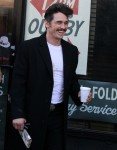 Tough guy James Franco swaps his folded newspaper for a biography of Joe Papp between takes on the set of HBO hit series 'The Deuce' in Bayridge, Brooklyn