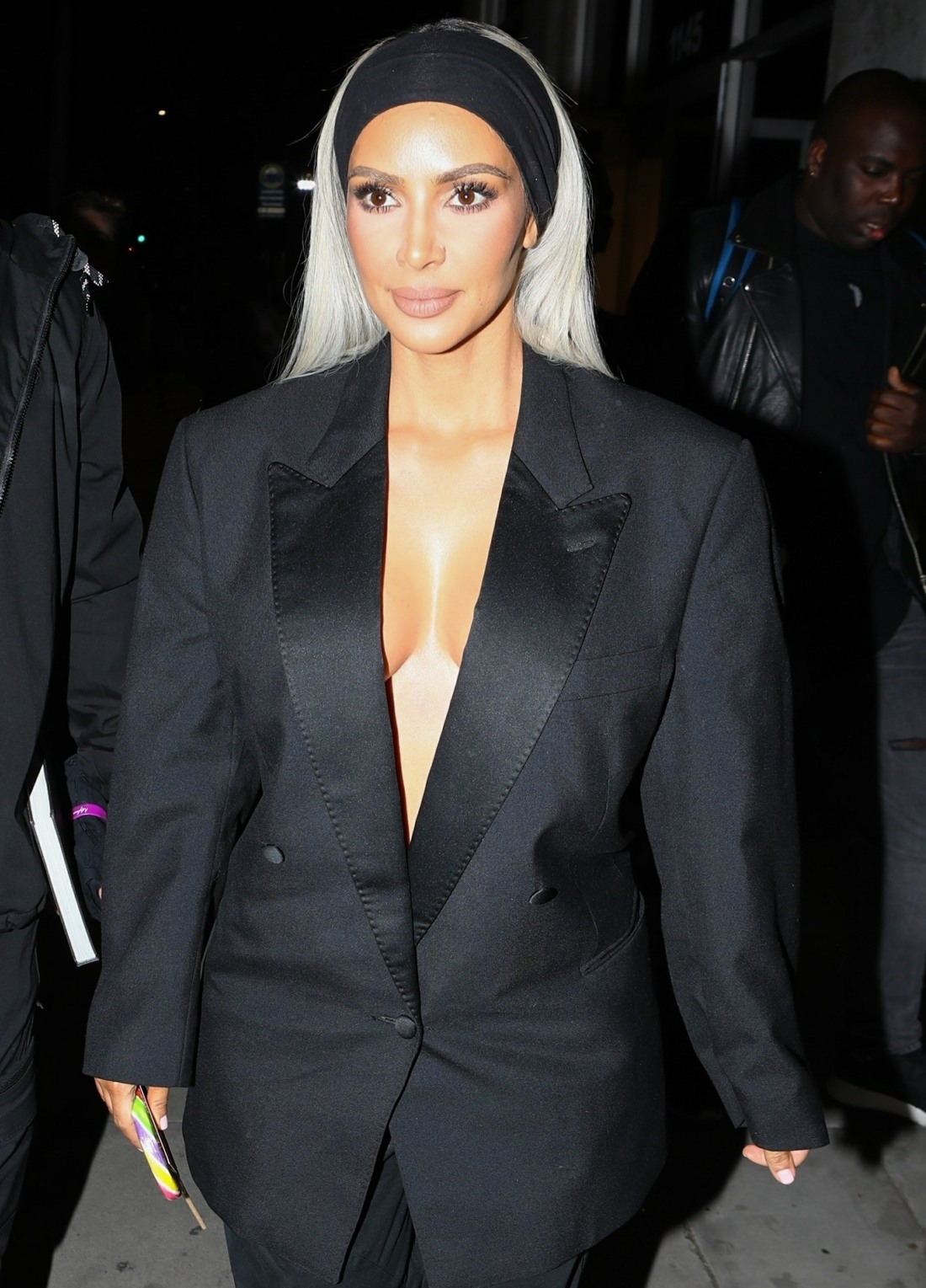 Kim Kardashian exits the Create & Cultivate Conference in a plunging suit
