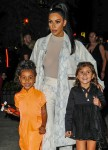Kim Kardashian and North have a big smile as they leave Cipriani Downtown