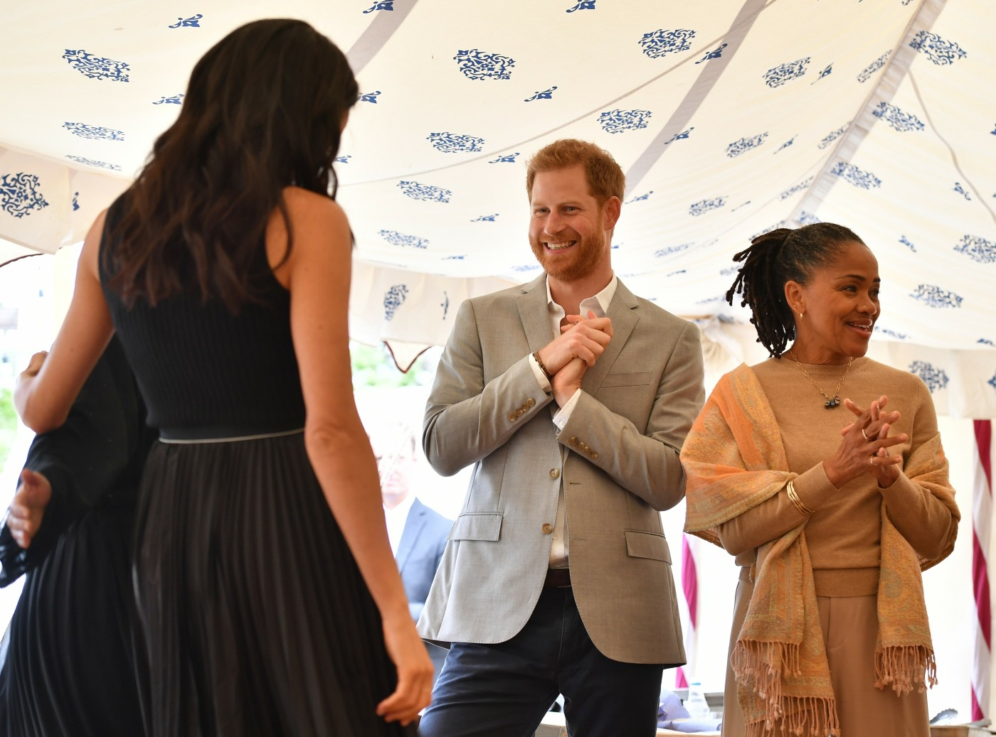 Meghan, Duchess of Sussex (L), her mother, Doria Ragland (R) and Britain's Prince Harry, Duke of Sussex take part in the launch of a cookbook with recipes from a group of women affected by the Grenfell Tower fire at Kensington Palace in London on September 20, 2018.