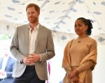 Britain's Prince Harry (L), Duke of Sussex and Doria Ragland listen to Meghan, Duchess of Sussex speaking at an event to mark the launch of a cookbook with recipes from a group of women affected by the Grenfell Tower fire at Kensington Palace in London on September 20, 2018.