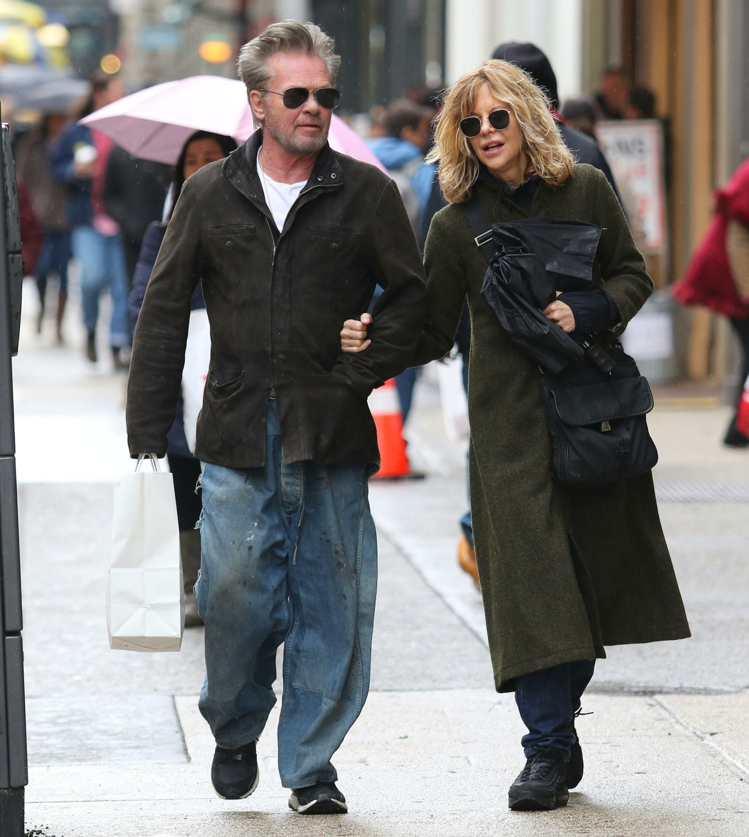 Meg Ryan and John Mellencamp take a romantic stroll arm-in-arm on a rainy day while shopping in Manhattan's SoHo neighborhood