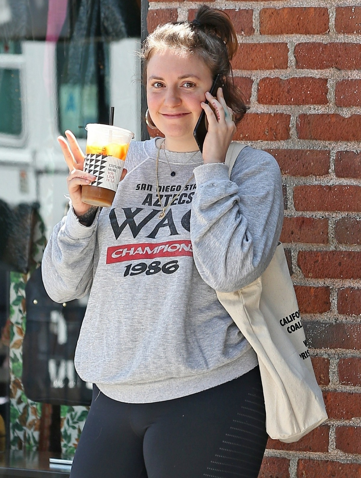 Smiling Lena Dunham makes a coffee stop in West Hollywood