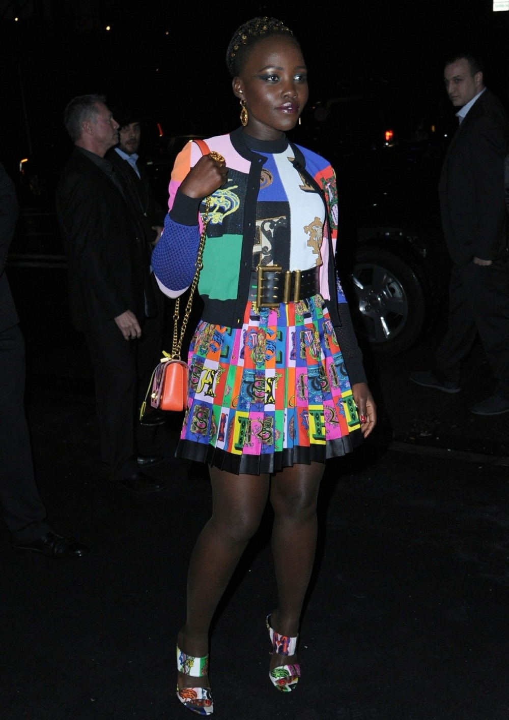 Lupita Nyong'o arrives at the Versace fashion show in New York