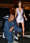 Kim Kardashian and Kanye West strike a pose in front of their NYC hotel