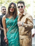 Priyanka Chopra and Nick Jonas are all smiles posing for pictures as newlyweds in Jodhpur, India