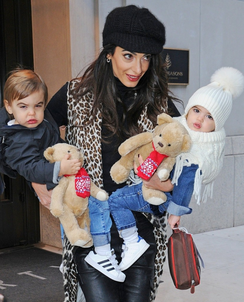 Amal Clooney is all smiles as she steps out with her children  Alexander and Ella