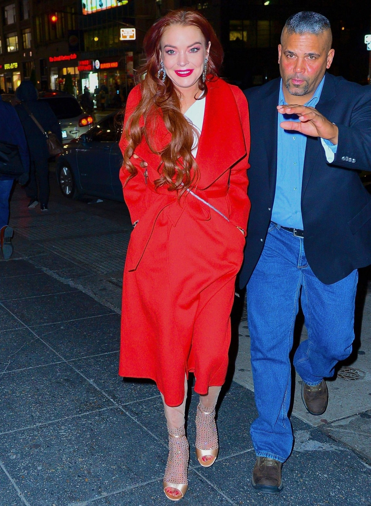 Lindsay Lohan is all smiles as she arrives for the Magic Hour rooftop party.