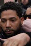 Jussie Smollett hides behind his bodyguards as he posts bond in Chicago