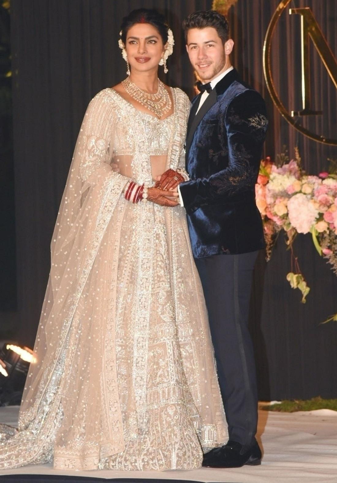 Priyanka Chopra and Nick Jonas pose for pictures at their wedding reception