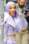 Cardi B heads out to run errands in a wild purple outfit