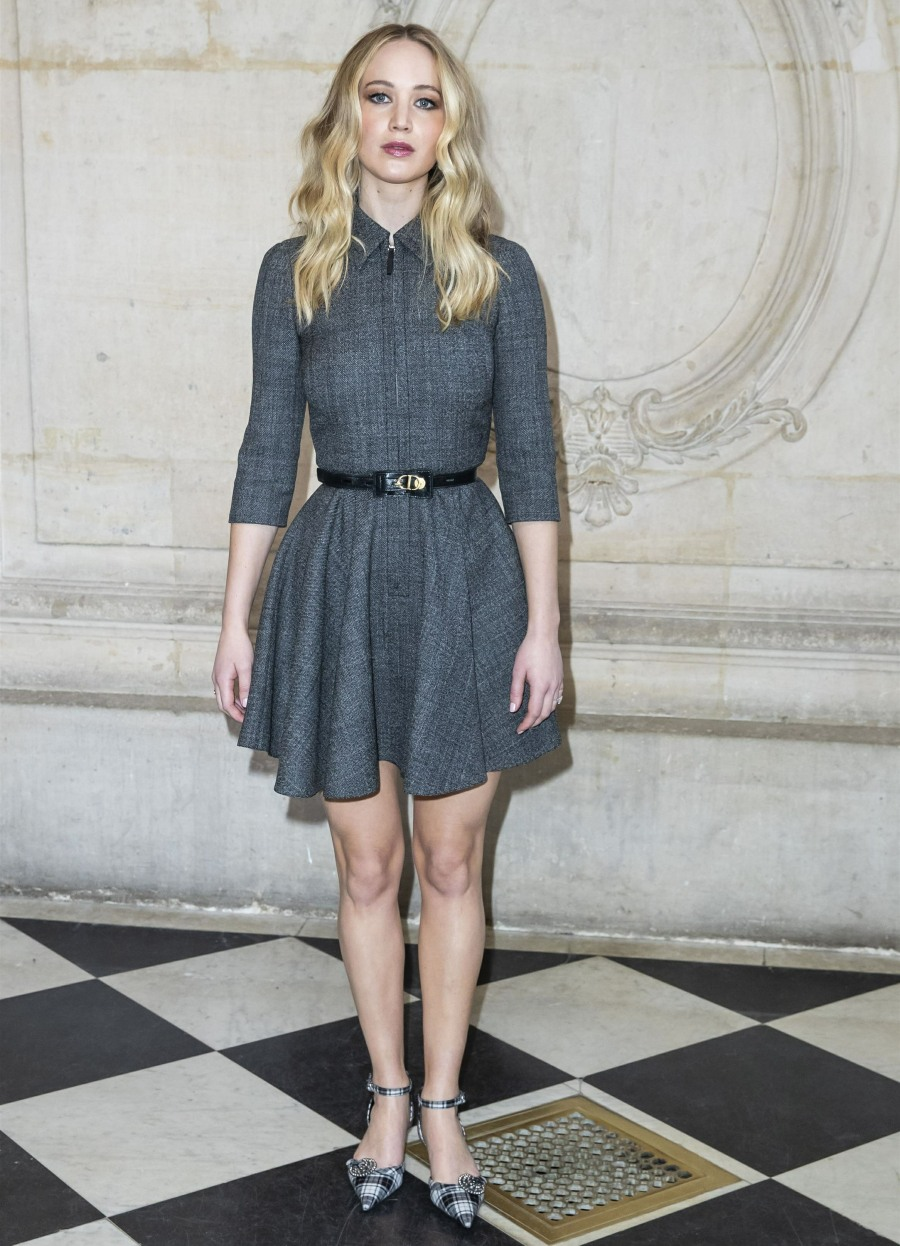 Guests pose in the press room for the Christian Dior fashion show