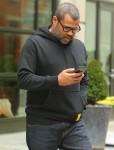 Jordan Peele checks messages outside the Crosby Hotel