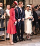 The Duchess of Cambridge talks with the Duchess of Sussex at Westminster Abbey C