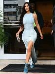 Kim Kardashian showcases her curves in skintight dress with thigh-high slit