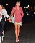 Taylor Swift steps out in colorful outfit for Gigi Hadid's birthday party