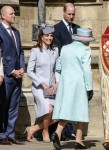 Kate, Duchess of Cambridge curtsies before HRH Queen Elizabeth II at the Easter Sunday church service at St.George's Chapel in Windsor Castle on Sunday April 21, 2019