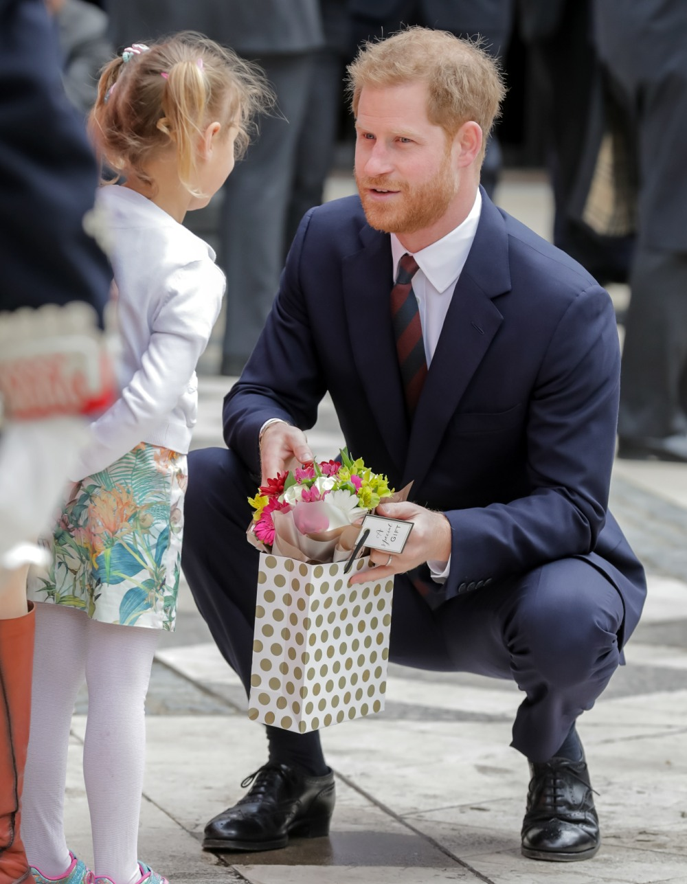 HRH Prince Harry, The Duke of Sussex receiving a boquet of flowers from Sophia, following the twelfth annual Lord Mayor's Big Curry Lunch in aid of the three National Service Charities: ABF The Soldiers' Charity, the Royal Navy and Royal Marines Charity and the Royal Air Force Benevolent Fund.