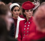 The Duchess of Cambridge sits near the Duchess of Sussex as they attend the West