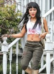 A bloody Constance Wu flaunts her abs on set!