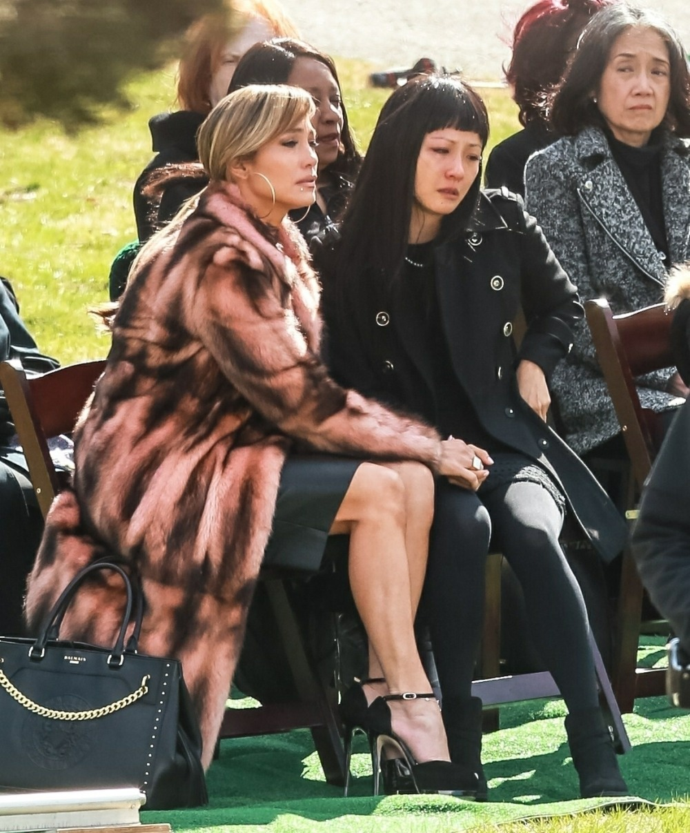 "Jennifer Lopez and Constance Wu film a scene  for ""Hustlers"" at The Woodlawn Cemetery"