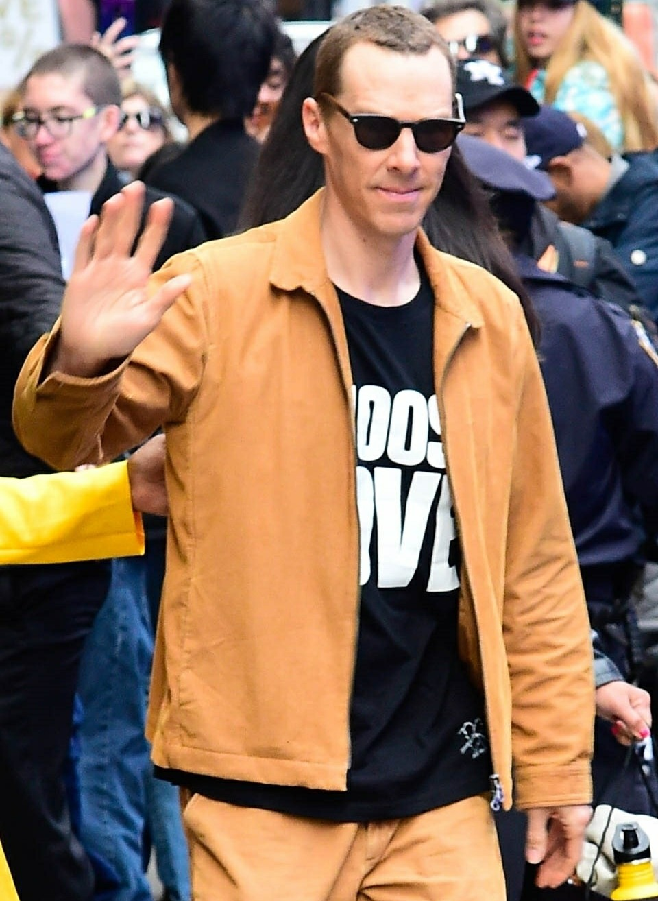 Benedict Cumberbatch smiles and waves while he is out and about in New York