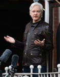 Julian Assange speaks to the media from the balcony of the Embassy Of Ecuador in London