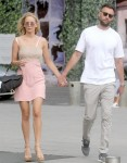 Jennifer Lawrence and Cooke Maroney hold hands on a walk through Place Vedome in Paris