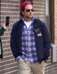 Bradley Cooper appears very serious getting a coffee in the West Village