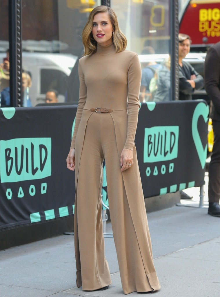 Allison Williams pictured in a light beige bodysuit while exiting The View
