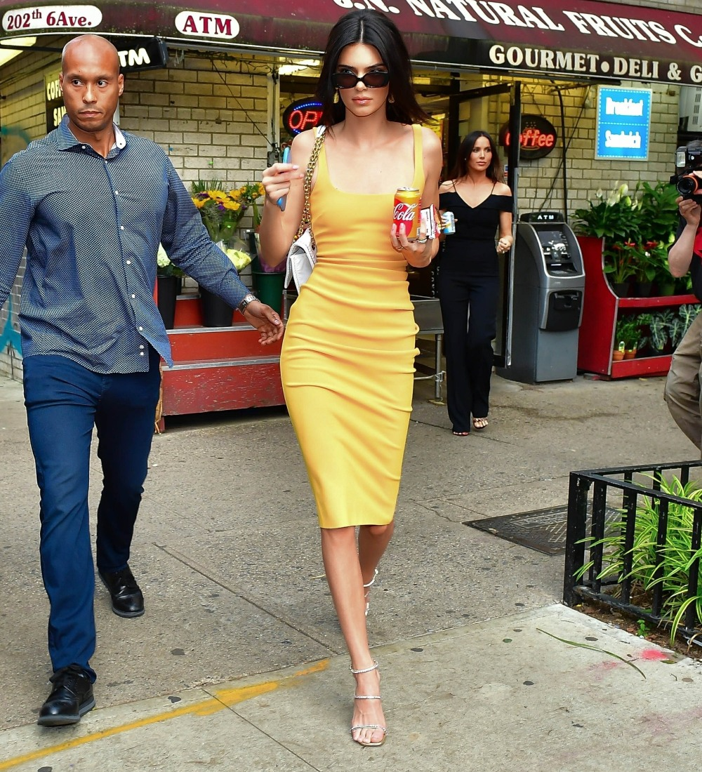 Kendall Jenner steps out in yellow for snacks at a New York deli
