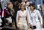 Queen Maxima of the Netherlands (C) laughs with the Duchess of Cambridge following the noble order of the Knights garter ceremony where her husband king Willem of the Netherlands (L) was made a member in St George's chapel in Windsor. The King of Spain a