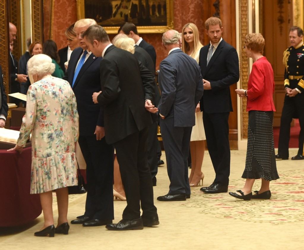 Prince Charles, Prince Harry, Ivanka Trump, Melania Trump, Queen Elizabeth II and Donald Trump view displays of US items from the Royal Collection at Buckingham Palace in London.
