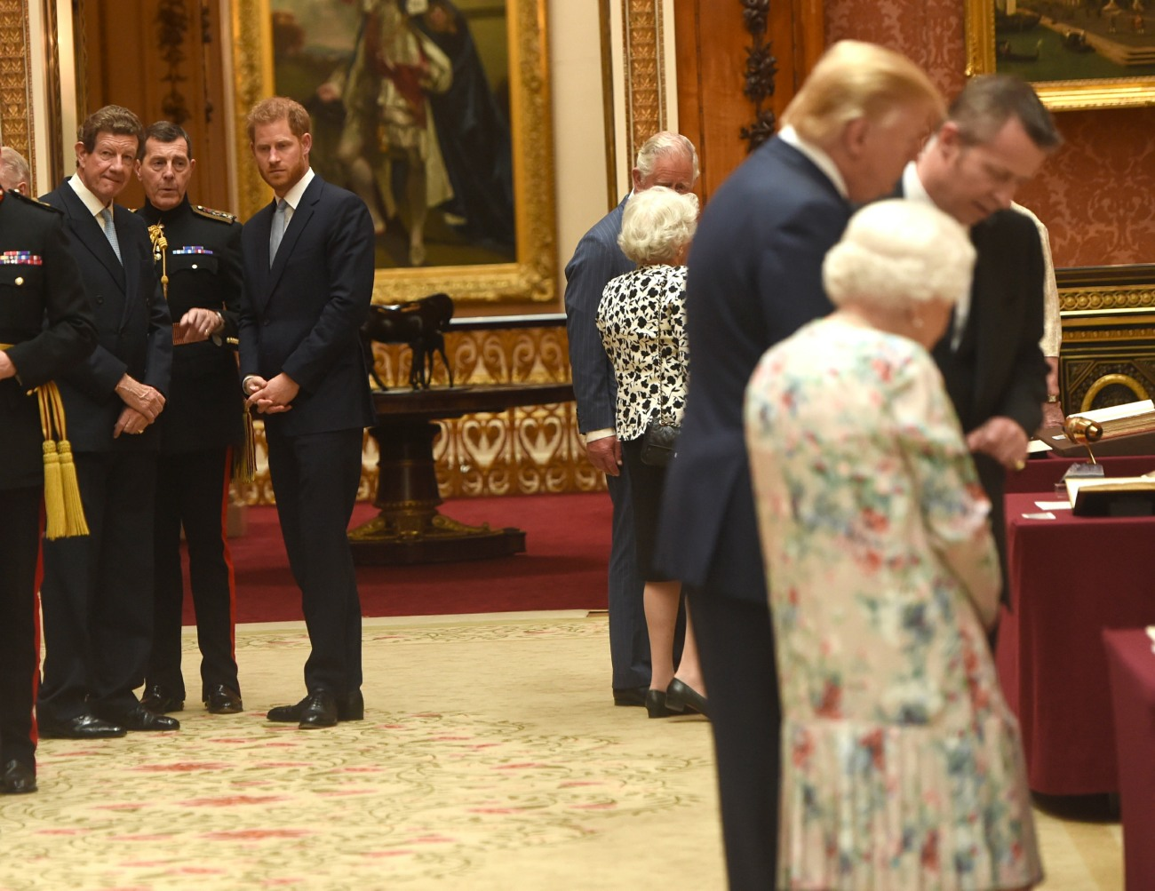 Prince Harry views displays of US items from the Royal Collection at Buckingham Palace in London.
