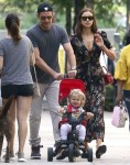 Bradley Cooper and his girlfriend Irina Shayk taking a stroll with their daughter Lea