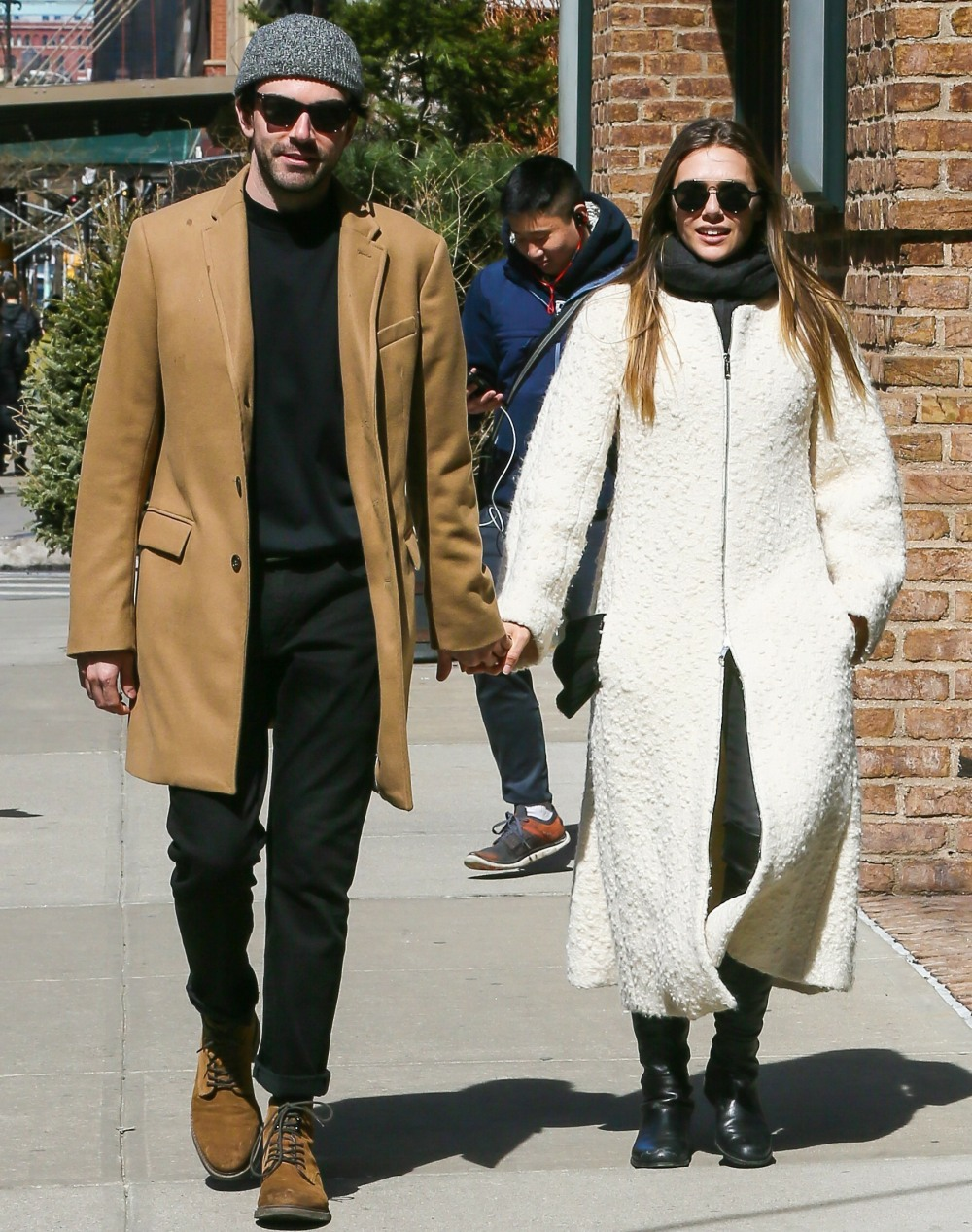 Elizabeth Olsen holding hands with a mystery guy out for a walk in New York