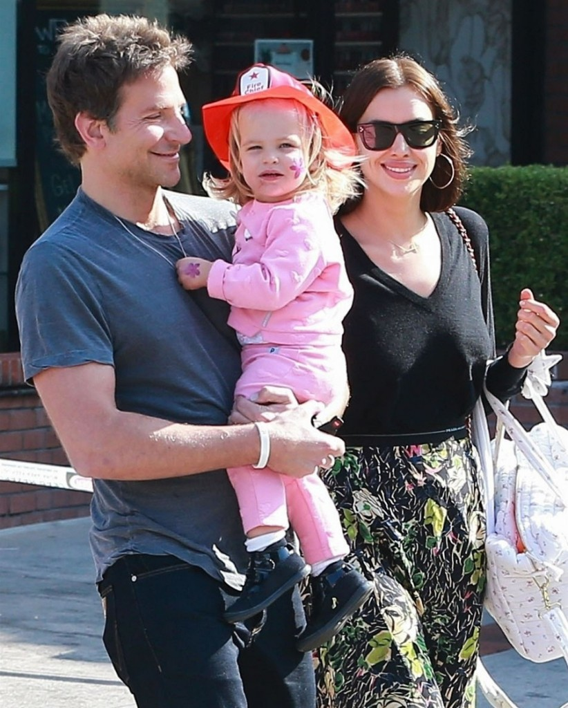 Bradley Cooper and Irina Shayk leave a birthday party with their little firefighter Lea